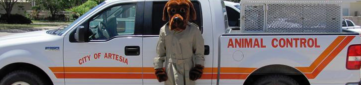 Person in Officer McGruff Costume in Front of Animal Control Truck